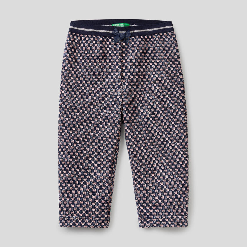 Trousers with two-tone geo motif