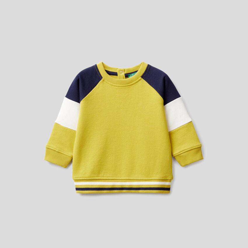 Yellow sweatshirt with color block sleeves